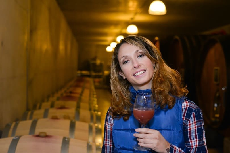 woman with wine in wine cellar